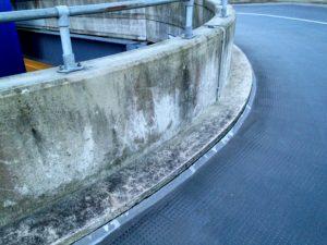 Crack along edge of asphalt car park ramp